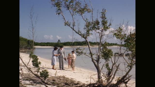 ws family walking and enjoying on beach / united states - blazer jacket stock videos & royalty-free footage