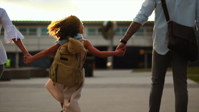 family walking at airport - holding hands stock videos & royalty-free footage