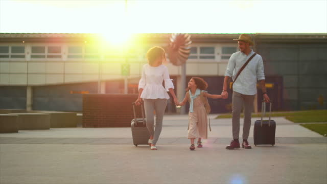 family walking at airport - wheeled luggage stock videos and b-roll footage