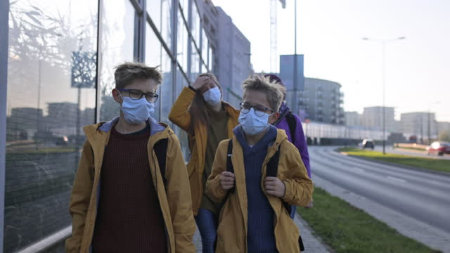 family walking during covid-19 pandemic - urban road stock videos & royalty-free footage