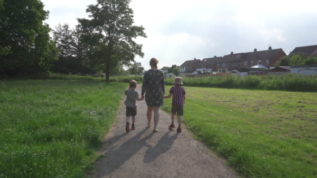 family walking in a park - holding hands stock videos & royalty-free footage