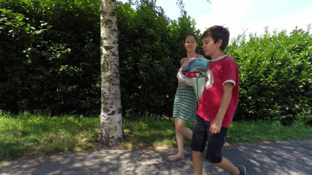 family walking in nature - sandal stock videos and b-roll footage