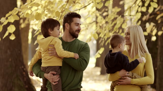 Family walking in the autumn park