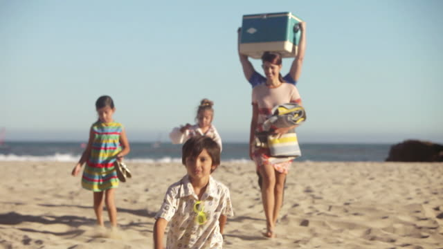 family walking on beach, father carrying coolbox - cooler container stock videos and b-roll footage