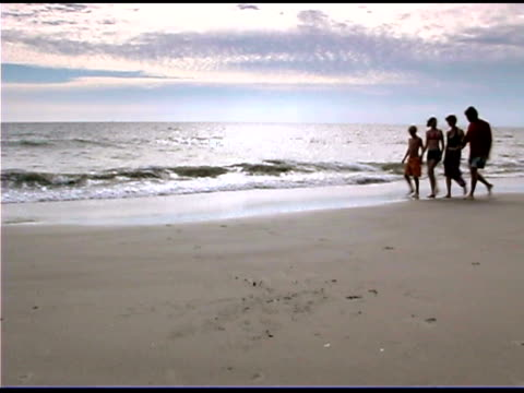 family walking on beach - see other clips from this shoot 1335 stock videos and b-roll footage