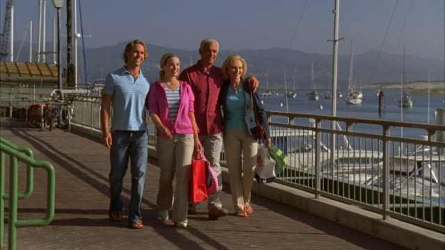 WS, DS, Family walking on pier in Morro Bay, California, USA