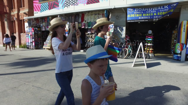 family walking on promenade at venice beach - venice beach stock videos & royalty-free footage