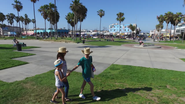 family walking on promenade at venice beach - promenade stock videos & royalty-free footage