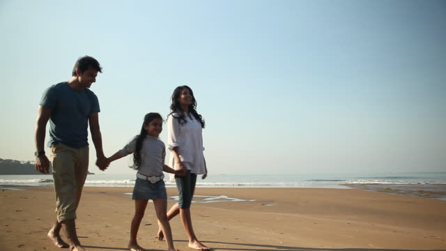 family walking on the beach - indian ethnicity stock videos & royalty-free footage