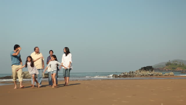family walking on the beach - multi generation family stock videos & royalty-free footage