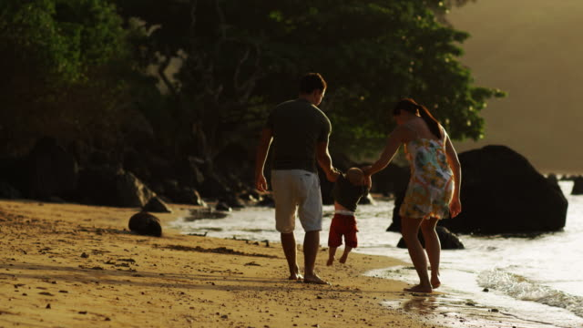 family walking on the beach - tropical climate stock videos & royalty-free footage