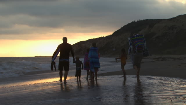family walking on the beach - see other clips from this shoot 1158 stock videos and b-roll footage