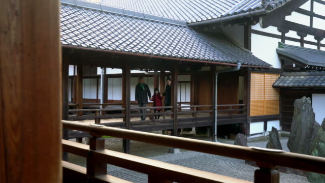 Family walking through a Japanese Temple