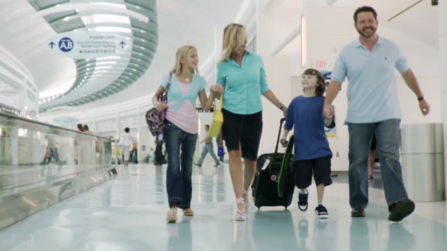 MS POV Family walking through airport / Jacksonville, FL, United States