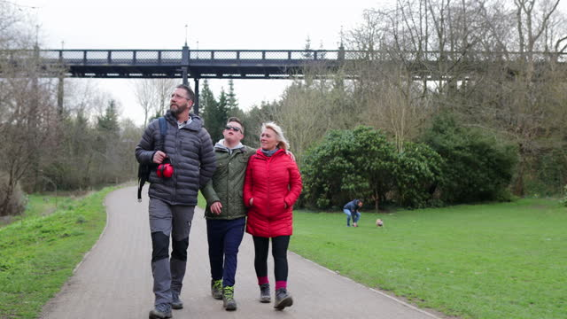 family walking through the park - 50 59 years stock videos & royalty-free footage