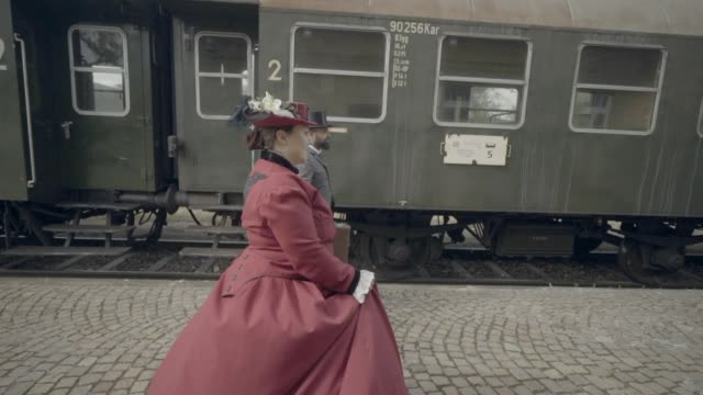 family walking through train yard - 19th century stock videos & royalty-free footage