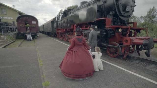 family walking through train yard - 19th century style stock videos & royalty-free footage