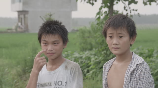 a family walks along a dirt road in a field in china. - two generation family stock videos & royalty-free footage