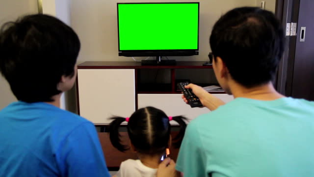 family watch chromakey tv - family watching tv stock videos and b-roll footage