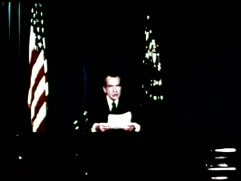 vídeos de stock e filmes b-roll de a family watches president richard nixon resign on television while barry goldwater gives a press conference - 1974