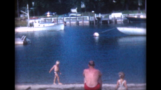 1959 family watches series of boats returning from regatta - regatta stock-videos und b-roll-filmmaterial