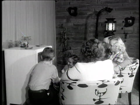 family watches the united states president dwight d. eisenhower deliver the first ever televised presidential address. - television show stock videos & royalty-free footage