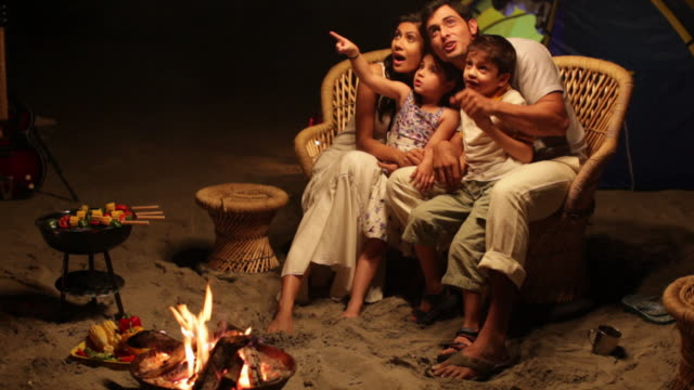 family watching stars at night  - skewer stock videos & royalty-free footage