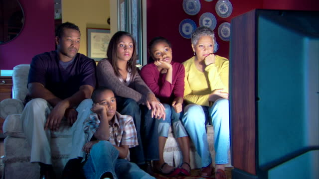 family watching television - boredom stock videos & royalty-free footage