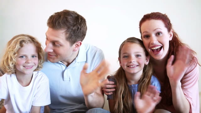 family waving their hands - film moving image stock videos & royalty-free footage