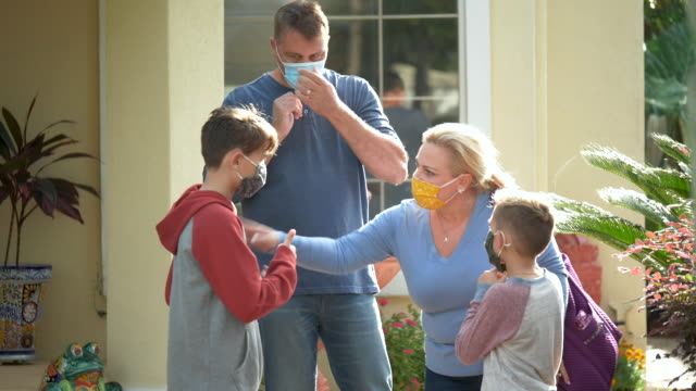 family wearing face masks as they leave home - 8 9 years stock videos & royalty-free footage
