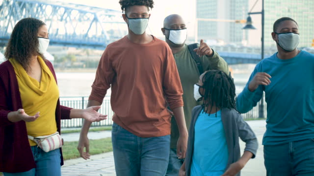 family wearing face masks during covid-19 pandemic - 16 17 years stock videos & royalty-free footage