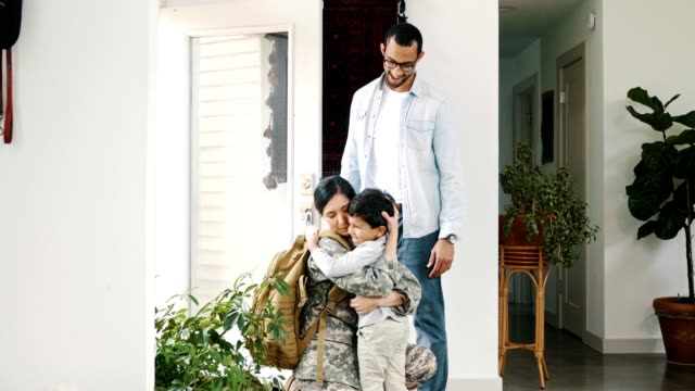 family welcomes female soldier home - homecoming stock videos & royalty-free footage