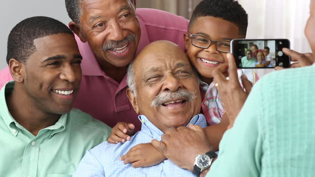 family with 4 generations of men having their picture taken with a smart phone - over 80 stock videos and b-roll footage