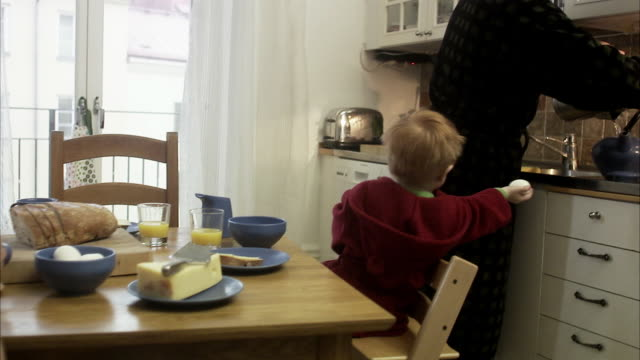 Family with a small child having breakfast, Sweden.