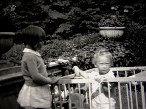 1931 family with baby in play pen - 1931 stock videos & royalty-free footage