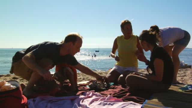 CU, Family with boy (4-5) having picnic on beach, North Truro, Massachusetts, USA