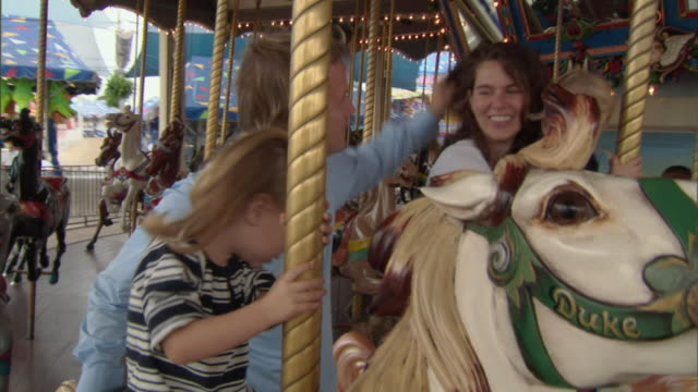ms, family with daughter (2-3) and son (12-17 months) on mary go round, dallas, texas, usa - 12 17 months stock videos & royalty-free footage