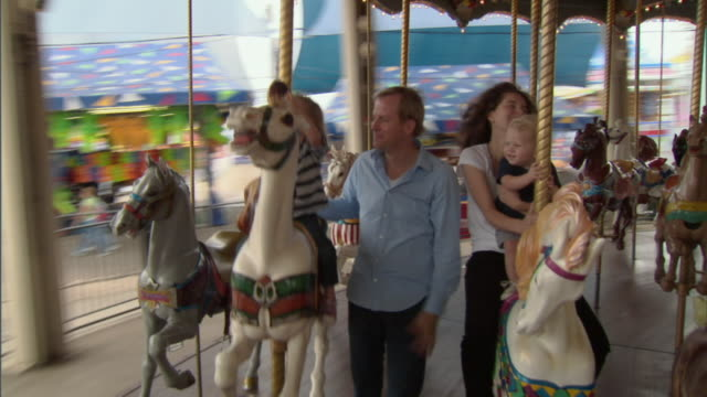 ms, family with daughter (2-3) and son (12-17 months) on mary go round, dallas, texas, usa - 12 23 months stock videos & royalty-free footage