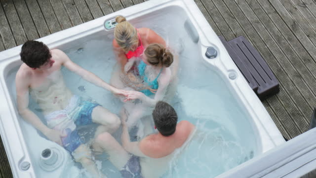 family with daughter in hydrotherapy hot tub - bagno caldo video stock e b–roll