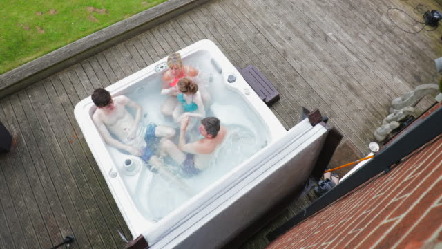 family with daughter in hydrotherapy hot tub - hot tub stock videos & royalty-free footage