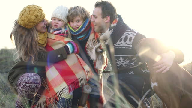 ms family with dog walking on hill - familie mit zwei kindern stock-videos und b-roll-filmmaterial