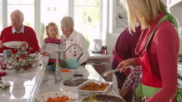 Family With Grandparents Prepare Christmas Meal Shot On R3D