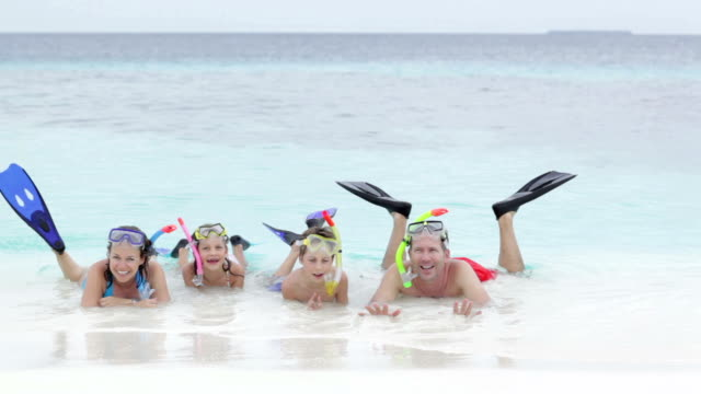 family with kids and snorkeling gear - stehendes gewässer stock-videos und b-roll-filmmaterial
