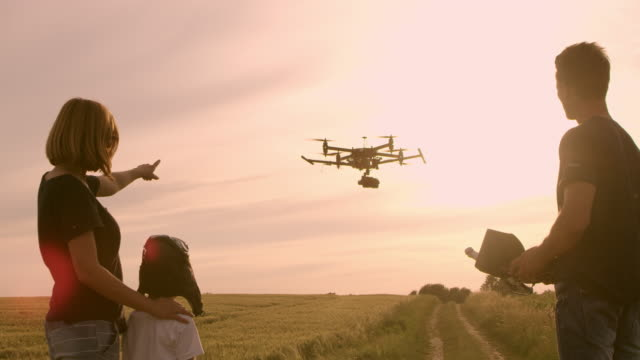 WS Family with one child playing with a drone