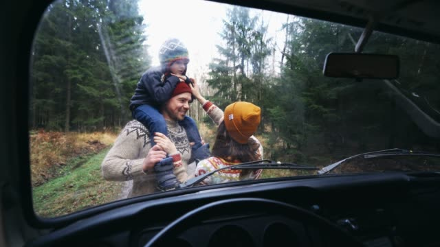 family with son  near the van in forest - getting away from it all stock videos & royalty-free footage
