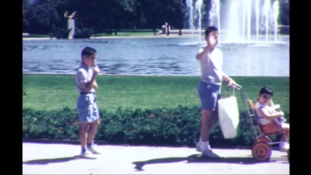 1964 Family With Stroller at Fountain