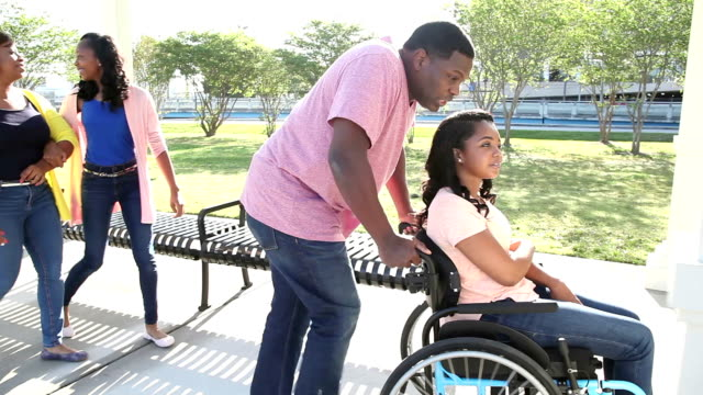 Family with teenage daughter in wheelchair