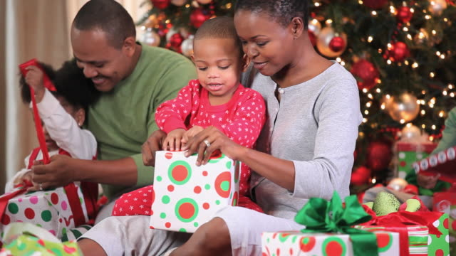 ms pan family with three children (2-3, 8-9) opening presents on christmas morning / richmond, virginia, usa - family with three children stock videos & royalty-free footage