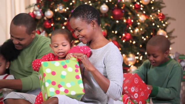 ms td pan family with three children (2-3, 8-9) opening presents on christmas morning / richmond, virginia, usa - family with three children stock videos & royalty-free footage