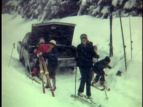 1975 ws family with three children preparing ski gear at car, ripton, vermont, usa - family with three children stock videos & royalty-free footage